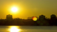 Orange sunset over river in city.4K ((3840x2160)   Time lapse without birds, RAW Stock Footage