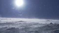 Snowstorm sun with small ice crystals on top of the mountain  slow motion Stock Footage