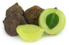 Amla fruits - dried and green - stock photo