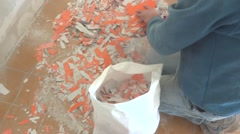 Painter peeling off old paint from wall Stock Footage