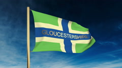 Gloucestershire flag slider style with title. Waving in the wind with cloud Stock Footage