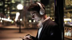 Man with smartphone in city at night Stock Footage
