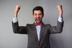 Very happy casual young man wearing tweed jacket - stock photo