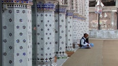 People talk at the entrance to the Star Mosque in Dhaka, Bangladesh. - stock footage