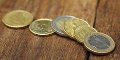 British Pound and Euro coins - stock photo