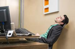 Overworked, tired young businessman sleeping Stock Photos
