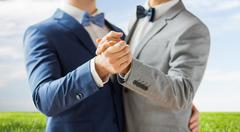 Stock Photo of close up of happy male gay couple dancing