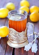 fresh tea with lemon in the cup - stock photo