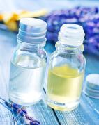 aroma oil in bottle and on a table - stock photo