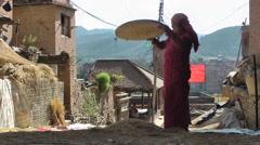 Farmer ladies winnowing grain,Bhaktapur,Nepal Stock Footage