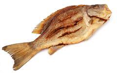 Dried Barramundi or Koral fish of Southeast Asia Stock Photos