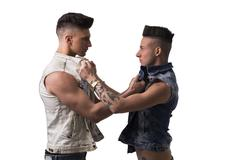 Two aggressive young men - stock photo