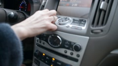 Changing volume of the radio on button panel in Infiniti Stock Footage