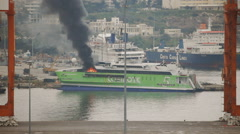 Port accident live,passenger ferry on fire Piraeus port, Athens Greece Stock Footage