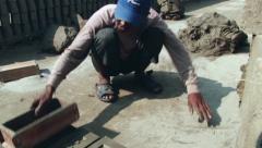 Man forms bricks from clay at the factory in Dhaka, Bangladesh. Stock Footage