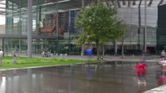 Long exposure time-lapse Kids running around in Downtown Dallas reflection pool - stock footage