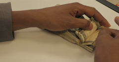 A Man Counting Mauritanian Money at a Bank (4K) Stock Footage