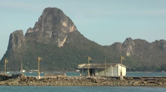 Carst mountain and pier,low angle,Prachuap khiri khan,Thailand Stock Footage