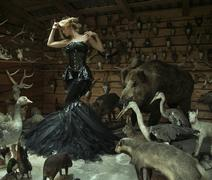 Sensual woman in a locked room full of wild animals - stock photo