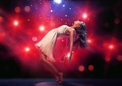 Flexible ballet dancer on the dance floor - stock photo