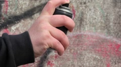Hand with color spray can near the wall Stock Footage