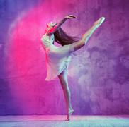 Flexible young ballet dancer on the dance floor - stock photo