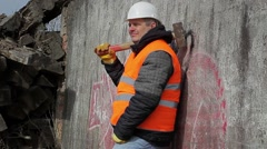 Worker with sledge hammer near the wall Stock Footage