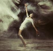 Ballet dancer in the magic dust figure Stock Photos