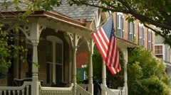 American house golden hour flag 2 of 2 Stock Footage