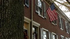 American flag on a row home 1 of 3 Stock Footage