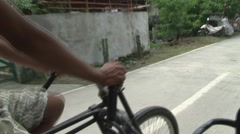Bicycle taxi pedaler outside Manila POV street Stock Footage