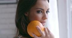 Seductive Woman Holding Fresh Orange Fruit Stock Footage