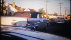 1956 - vintage cars drive through 1950's suburbia - vintage film home movie Stock Footage