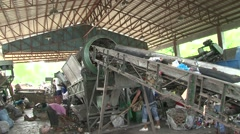 Garbage sorting machine with trash on conveyor belt in Philippines Stock Footage
