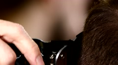 Stylish men's hairdresser: Master in tattoos makes hair young man close up Stock Footage