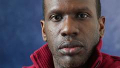 African American man, closeup face, serious Stock Footage
