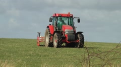 farming agriculture tractor farmer red skyline - stock footage