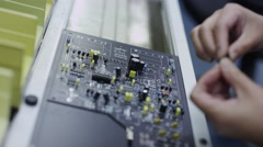 Electronics Manufacturing - Factory workers assembling circuit boards Stock Footage