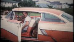 1952 - man shows off his new 1956 Mercury - vintage film home movie Stock Footage