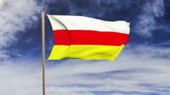 South Ossetia flag waving in the wind. Green screen, alpha matte. Loopable Stock Footage