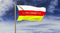South Ossetia flag with title waving in the wind. Looping sun rises style Stock Footage