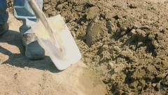 Digging up the field before planting with a shovel Stock Footage