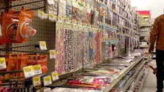 Woman choosing scrapbooks inside Walmart store. Stock Footage