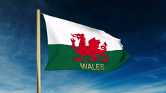 Wales flag slider style with title. Waving in the wind with cloud background Stock Footage