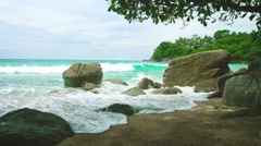 Tropical sea shore. Rocks and sand without people Stock Footage
