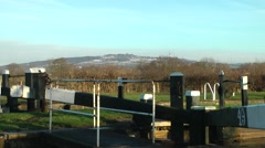 Trent and Mersey canal lock Mow Cop folley in distance Stock Footage