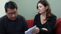 Hispanic couple with financial troubles - stock footage
