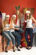 Four alluring girls promoting the Christmas - stock photo