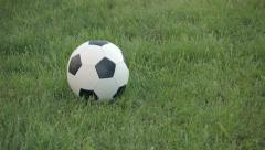 Closeup of Football Rolling Into Frame on Grass Stock Footage
