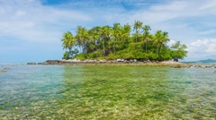 Small Tropical Island at Low Tide under Cloudy Skies Stock Footage